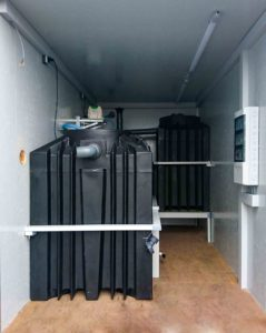 Biological waste water treatment in modular container